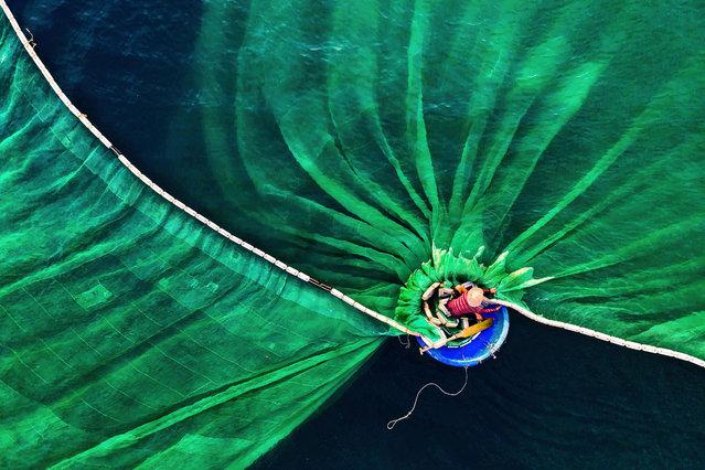 Dance in the Sea by Le Van Vinh, Vietnam: fisherman in Hon Yen, Phu Yen, Vietnam. Winner – people in nature. (Photo by Le Van Vinh/The Nature Conservancy Global Photo Contest 2019)