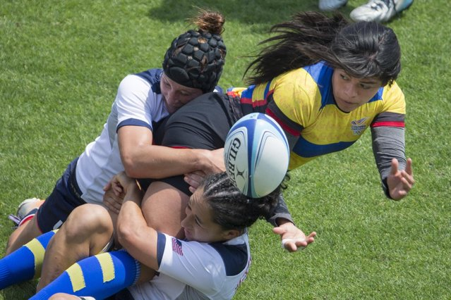 Colombia's Ana Catalina Ramirez Talero, right, is tackled by Team USA's Lauren Doyle, left, and Kelly Griffin during women's rugby sevens at the 2015 Pan Am Toronto games in Toronto, Saturday, July 11, 2015. (Photo by Chris Young/The Canadian Press via AP Photo)
