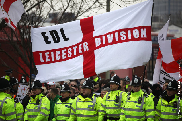 Members of the English Defence League (EDL) take part in a demonstration through the streets of Leicester