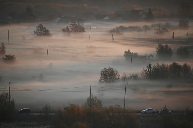 A morning fog is seen in the Siberian city of Omsk, Russia on October 8, 2019. (Photo by Alexey Malgavko/Reuters)