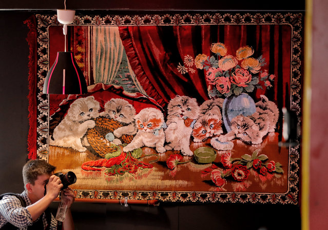 In this Thursday, May 4, 2017, photo a news photographer works inside the newly opened Bucharest Kitsch Museum, in Bucharest, Romania. The Kitsch Museum opens for visitors on Friday, May 5, 2017. (Photo by Vadim Ghirda/AP Photo)