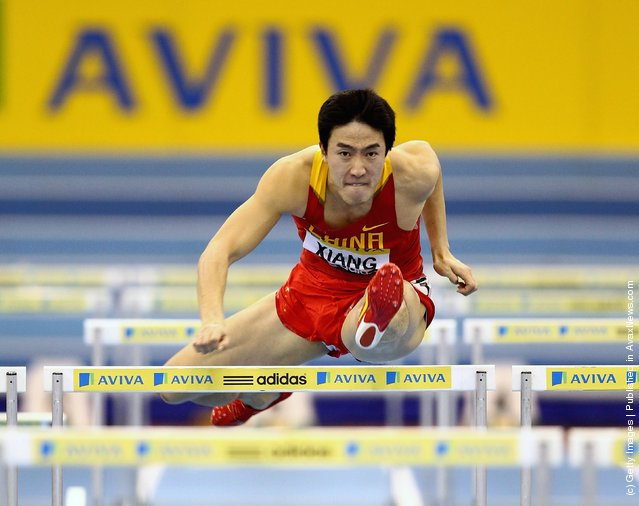 Liu Xiang of China in action on his way to winning during the Aviva Grand Prix at the NIA Arena