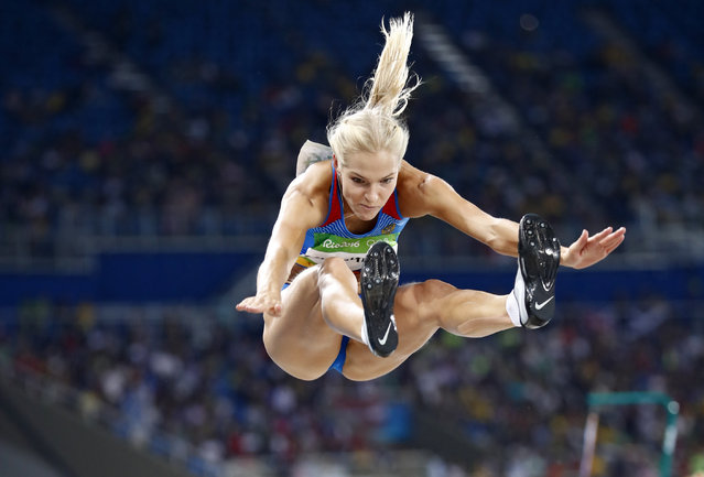 Dariya Klishina of Russia makes an attempt during the women's Long Jump Qualifying round of the Rio 2016 Olympic Games Athletics, Track and Field events at the Olympic Stadium in Rio de Janeiro, Brazil, 16 August 2016. (Photo by Diego Azubel/EPA)