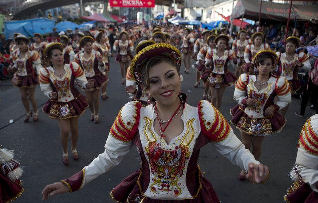 """Dancers perform the """"Caporales"""" during the annual parade in honor of """"El Senor del Gran Poder"""" in La Paz, Bolivia, Saturday, June 10, 2017. (Photo by Juan Karita/AP Photo)"""
