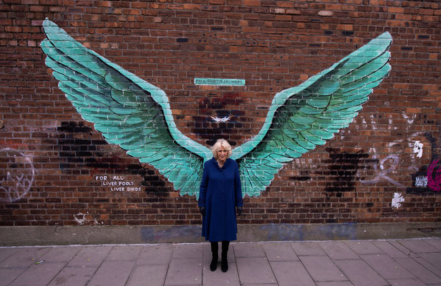 """Britain's Camilla, the Duchess of Cornwall poses in front of a mural entitled """"For All Liverpool's Liver Birds"""" during a visit in Liverpool, Britain, 12 February 2019. (Photo by Peter Powell/EPA/EFE)"""