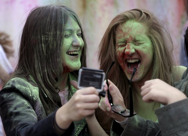 People react during the Holi festival, or the Festival of Colors, in Riga, Latvia, August 1, 2015. (Photo by Ints Kalnins/Reuters)
