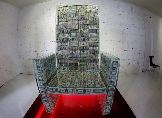"""Art object """"Money throne x10"""", a glass throne filled with $1 million, created by Russian artist Alexey Sergienko and entrepreneur Igor Rybakov, is seen during a presentation in Moscow, Russia on November 29, 2019. (Photo by Tatyana Makeyeva/Reuters)"""