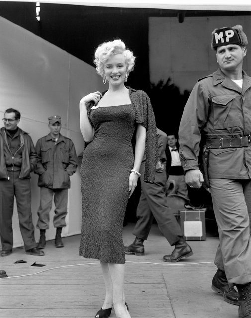 Marilyn Monroe visits troops in Korea during a USO tour, 1954. (Photo by Eddie Adams/The Guardian)