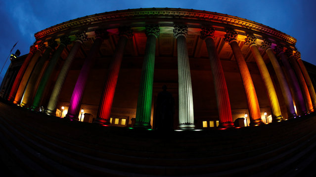 St Georges Hall is illuminated with a rainbow flag in Liverpool, northern England, June 13, 2016. (Photo by Phil Noble/Reuters)