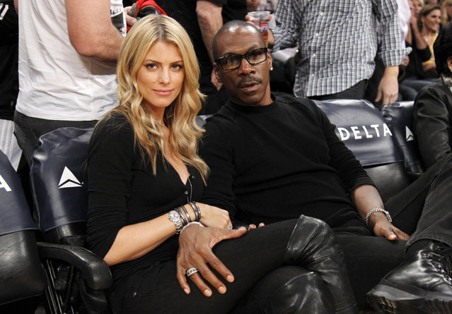 Eddie Murphy and Australian model Paige Butcher sitting courtside as the Lakers play the Suns in Los Angeles, November 2012. (Photo by Danny Moloshok/Reuters)