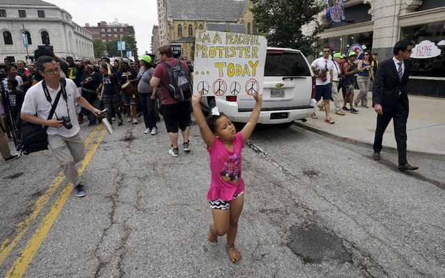 A young protester marches in downtown St. Louis August 10, 2015. (Photo by Rick Wilking/Reuters)