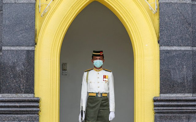 A Malaysian Royal Guard wears a protective mask while he stands guard outside National Palace, following the outbreak of a new coronavirus in China, in Kuala Lumpur, Malaysia, February 10, 2020. (Photo by Lim Huey Teng/Reuters)