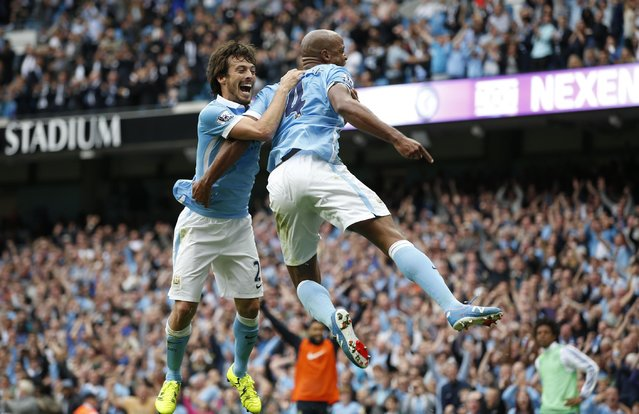 Football, Manchester City vs Chelsea, Barclays Premier League, Etihad Stadium on August 16, 2015: Vincent Kompany celebrates with David Silva after scoring the second goal for Manchester City. (Photo by Andrew Yates/Reuters/Livepic)