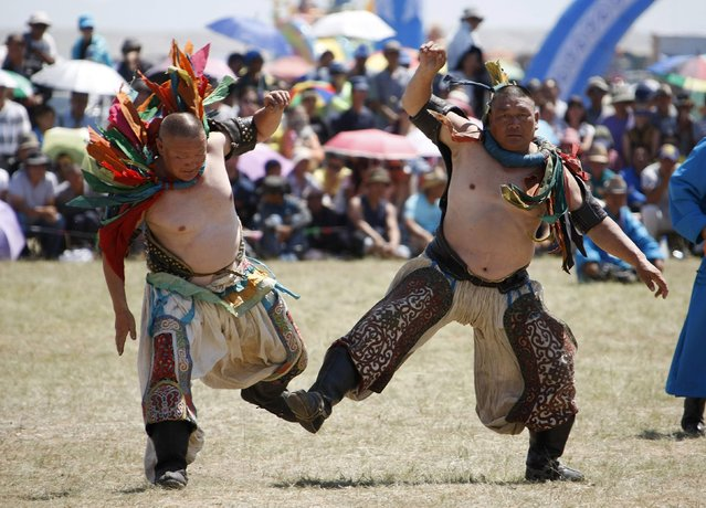 Wrestlers dance during the traditional Nadam Fair in Xilin Gol League, in China's Inner Mongolia Autonomous Region, July 30, 2014. Around 768 people, including children and women wrestlers, participated in the event, according to local media. (Photo by Jacky Chen/Reuters)