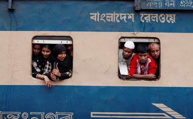 People stand in the windows of an overcrowded passenger train as they travel home to celebrate Eid al-Fitr festival, which marks the end of the Muslim holy fasting month of Ramadan, at a railway station in Dhaka, Bangladesh, July 5, 2016. (Photo by Adnan Abidi/Reuters)