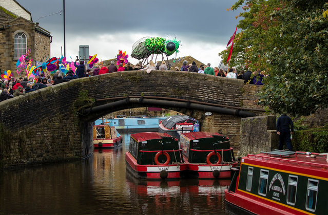 Hundreds of puppeteers take part in the Puppet Parade, one of the highlights of the Skipton The puppet Festival in Yorkshire, England on October 6, 2019. (Photo by Danny Lawson/PA Images via Getty Images)