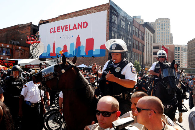 Cleveland police officers on horseback depart after clashes with a group attempting to burn a U.S. flag while protesting near the Republican National Convention in Cleveland, Ohio, U.S., July 20, 2016. (Photo by Lucas Jackson/Reuters)