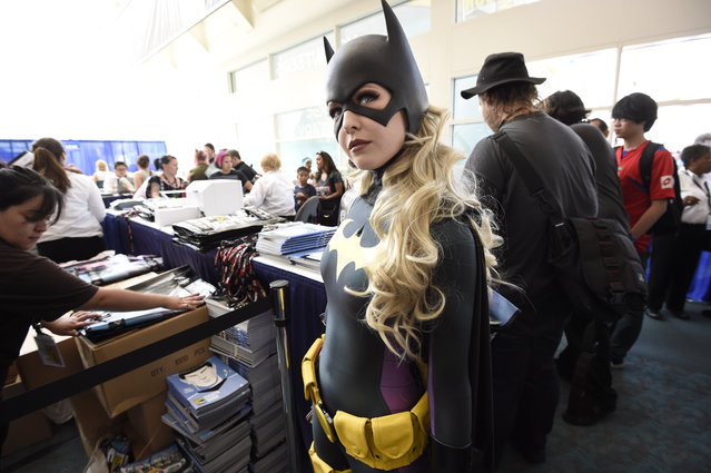 Jessica Chancellor, dressed as Batgirl, waits in line for her credential on Preview Night at Comic-Con International held at the San Diego Convention Center Wednesday, July 20, 2016, in San Diego. (Photo by Denis Poroy/Invision/AP Photo)