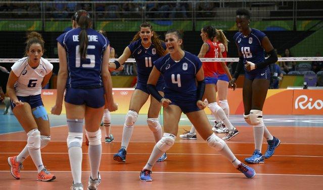 2016 Rio Olympics, Volleyball, Women's Preliminary, Pool B Serbia vs Italy, Maracanazinho, Rio de Janeiro, Brazil on August 6, 2016. (L-R) Monica De Gennaro (ITA) of Italy, Antonella Del Core (ITA) of Italy, Cristina Chirichella (ITA) of Italy, Alessia Orro (ITA) of Italy and Paola Egonu (ITA) of Italy celebrate scoring a point. (Photo by Marcelo del Pozo/Reuters)