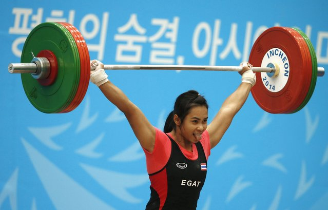 Thailand's Gulnoi Rattikan competes in the women's 58kg snatch weightlifting competition at the Moonlight Festival Garden during the 17th Asian Games in Incheon September 22, 2014. (Photo by Jason Reed/Reuters)