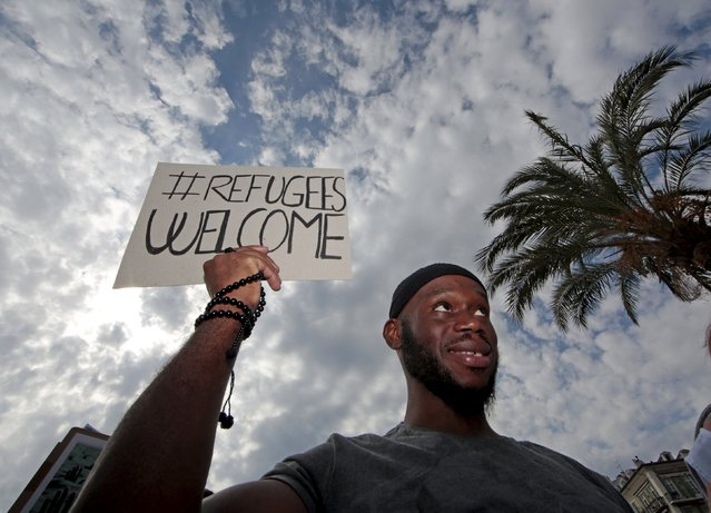 """A man holds a poster which reads """"Refugees Welcome"""" during a demonstration in support of migrants and refugees as part of the European Day of Action in Nice, southeastern France, September 12, 2015. (Photo by Eric Gaillard/Reuters)"""