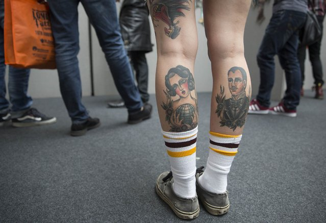 A woman displays tattoos on her legs during the 10th International Tattoo Convention in London September 27, 2014. (Photo by Neil Hall/Reuters)