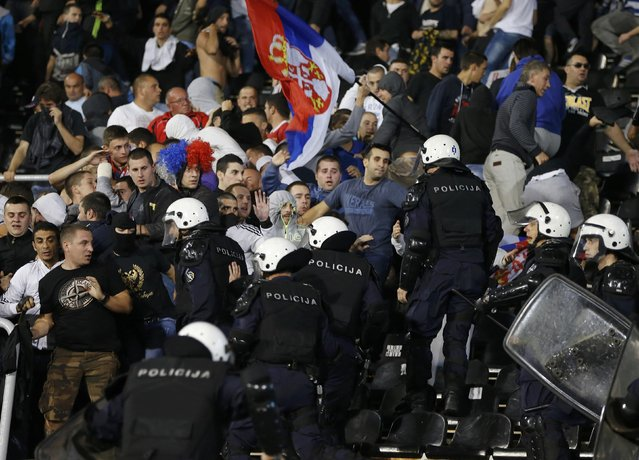 Riot police clashes with fans during the Euro 2016 Group I qualifying soccer match between Serbia and Albania at the FK Partizan stadium in Belgrade October 14, 2014. (Photo by Marko Djurica/Reuters)