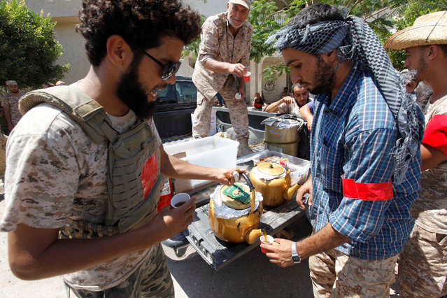 Donated tea and other drinks are distributed among Libyan forces as they prepare for next advance against Islamic State holdouts in Sirte, Libya August 29, 2016. (Photo by Ismail Zitouny/Reuters)