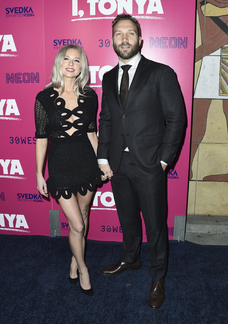"""Mecki Dent, left, and Jai Courtney arrive at the Los Angeles premiere of """"I, Tonya"""" at the Egyptian Theatre on Tuesday, December 5, 2017. (Photo by Jordan Strauss/Invision/AP Photo)"""