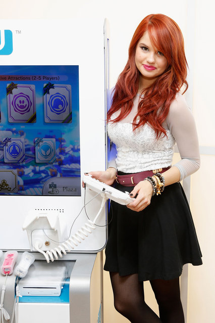 """Actress Debby Ryan attends """"How You Will Play Next"""" at the Nintendo World Store during the Wii U Showdown on December 1, 2012 in New York City. (Photo by Cindy Ord for Nintendo)"""