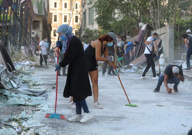 Volunteers clean the streets following Tuesday's blast in Beirut's port area, Lebanon on August 5, 2020. (Photo by Mohamed Azakir/Reuters)