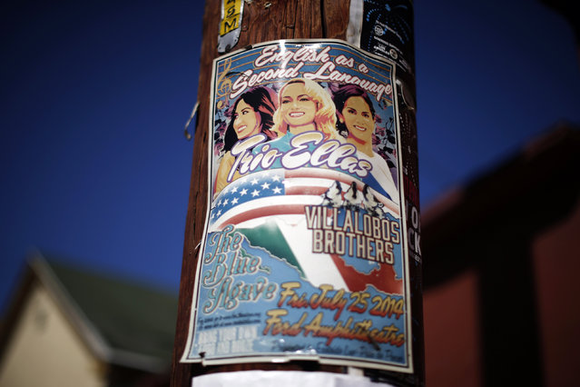 """A flyer for a concert named """"English as a Second Language"""", of Latino artists singing in Spanish and English, is seen in the Boyle Heights area of Los Angeles, home to many Mexican migrants, in California August 5, 2014. (Photo by Lucy Nicholson/Reuters)"""