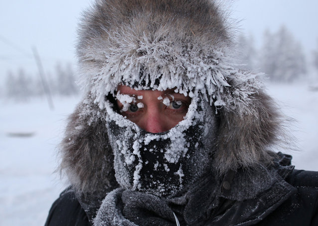 Photographer Amos Chapple while working in Oymyakon. The New Zealander says he occasionally had to avoid drunks in the town who threatened him with violence. (Photo by Amos Chapple/Courtesy Images/RFE/RL)