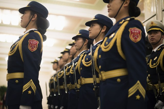 Members of the honour guard stand at attention, prior to a meeting between Chile's President Michelle Bachelet and Chinese President Xi Jinping at the Great Hall of the People in Beijing, November 12, 2014. (Photo by Fred Dufour/Reuters)