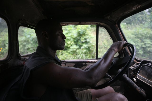 A labourer drives a truck used for transporting logs from an unreserved forest in Igede-Ekiti township, southwest Nigeria, August 19, 2014. (Photo by Akintunde Akinleye/Reuters)