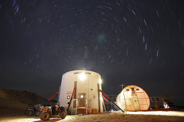 A view of the night sky above the Mars Desert Research Station (MDRS) is seen outside Hanksville in the Utah desert March 2, 2013. The MDRS aims to investigate the possibility of a human exploration of Mars and takes advantage of the Utah desert's Mars-like terrain to simulate working conditions on the red planet. Scientists, students and enthusiasts work together to develop field tactics and study the terrain while wearing simulated spacesuits and carrying air supply packs. They live together in a small communication base with limited space and supplies. (Photo by Jim Urquhart/Reuters)