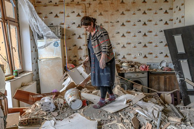 Xatire Celilova walks in the kitchen of her destroyed house following a ceasefire during a military conflict between Armenia and Azerbaijan over the breakaway region of Nagorno-Karabakh, in the town of Terter, Azerbaijan, on October 10, 2020. Armenia and Azerbaijan traded accusations of new attacks on October 10 in breach of a ceasefire deal to end nearly two weeks of heavy fighting over the disputed Nagorno-Karabakh region. (Photo by Bulent Kilic/AFP Photo)