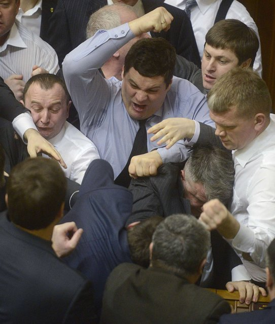 Ukrainian deputies scuffle during a session in the national Parliament in Kiev, Ukraine, on March 19, 2013. The Parliament was scheduled to debate the date of a mayoral election in Kiev, local media reported. (Photo by Reuters/Stringer)