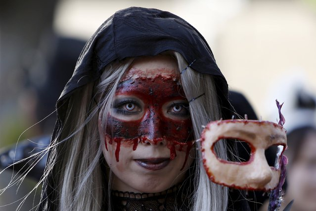 A participant in costume poses for a picture during a Halloween parade in Kawasaki, south of Tokyo, October 25, 2015. (Photo by Yuya Shino/Reuters)