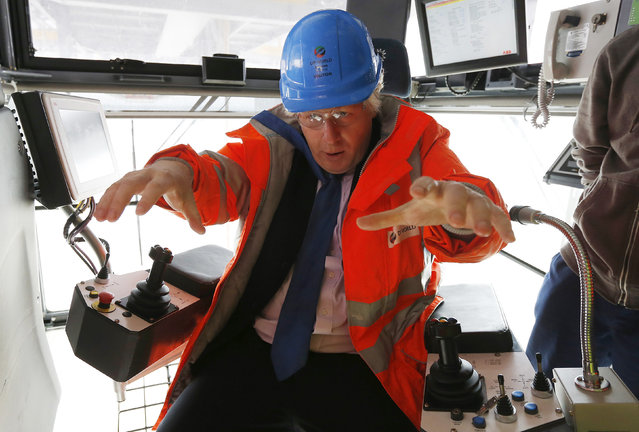 London Mayor Boris Johnson sits in the operator's cab of a crane on the quay at the DP World London Gateway container port in Essex, southern England July 30, 2013. (Photo by Suzanne Plunkett/Reuters)