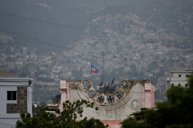 A flag of Haiti waves while Hurricane Matthew approaches in Port-au-Prince, Haiti October 3, 2016. (Photo by Carlos Garcia Rawlins/Reuters)