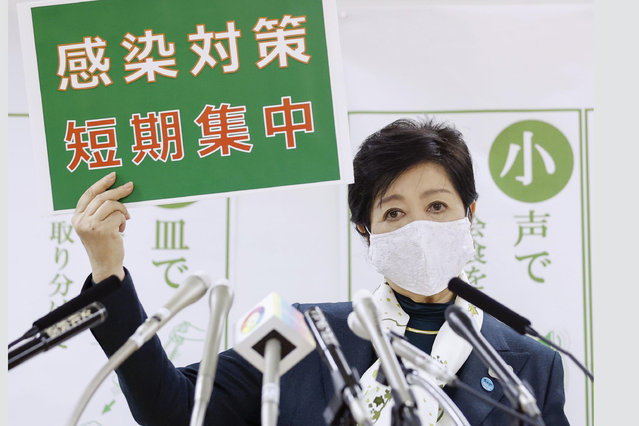 """Tokyo Gov. Yuriko Koike speaks during a news conference Wednesday, November 25, 2020, in Tokyo. The board reads """"infection control measures, Short and intensive"""". (Photo by Kyodo News via AP Photo)"""