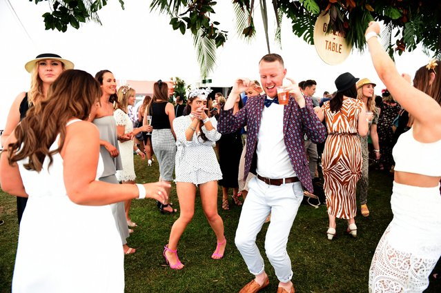 Race goers dance late into the afternoon after the Geelong Cup on Geelong Cup day at Geelong Racecourse in Melbourne, Australia, 19 October 2016. (Photo by Tracey Nearmy/EPA)