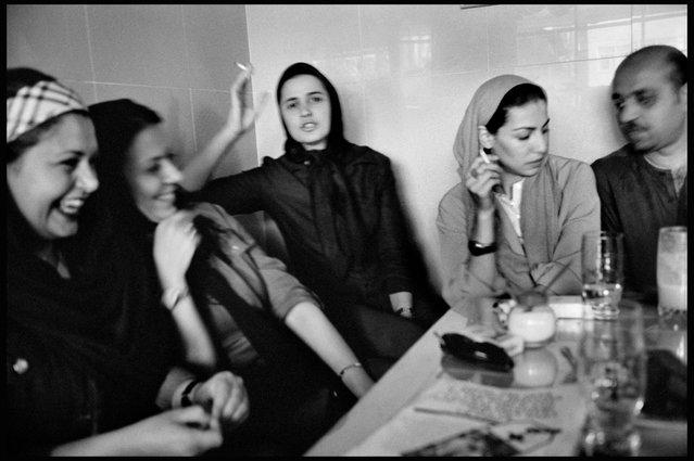 Tehran, Iran, 2001. A scene inside a fashionable coffee house. (Photo by Abbas Attar/Magnum Photos)