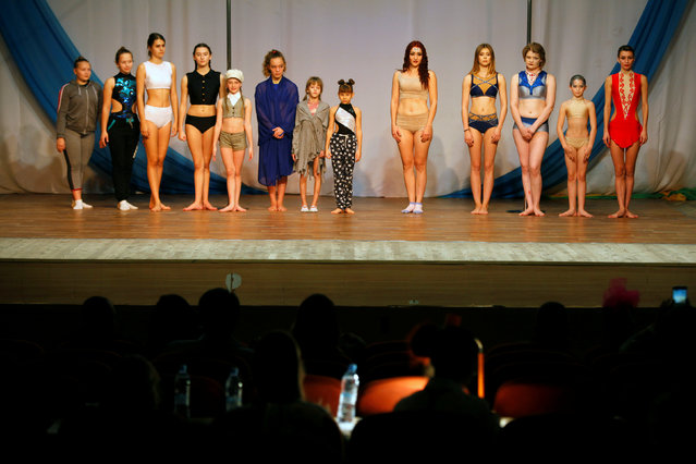 Participants present themselves before their competing at the Perfect Pole 2016 pole dance championship in the southern city of Stavropol, Russia, October 22, 2016. (Photo by Eduard Korniyenko/Reuters)