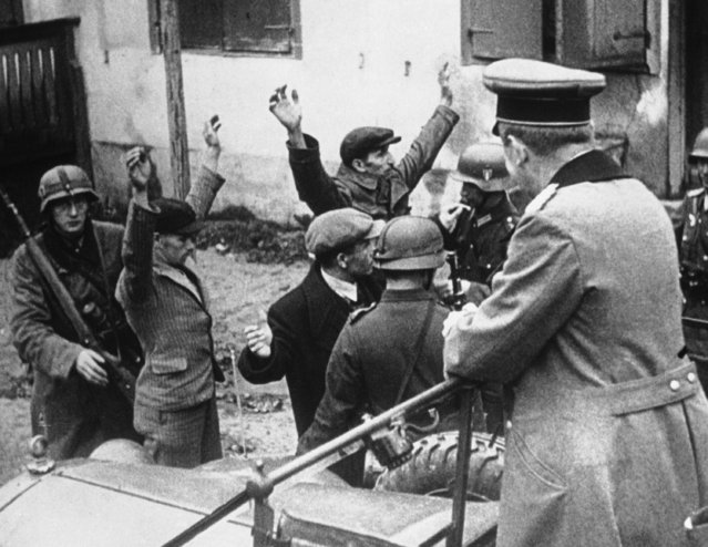 When German troops swept into this Polish seaport, civilians were searched for arms, as seen September 28, 1939 in Gdynia. (Photo by AP Photo)