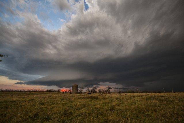 A thunderstorm rolls over farmland, on October 1, 2014, in Kansas. (Photo by Roger Hill/Barcroft Media)
