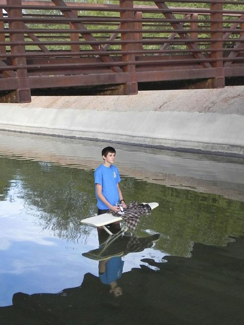 Extreme Ironing. (Photo by Kevin Krupitzer/Caters News)