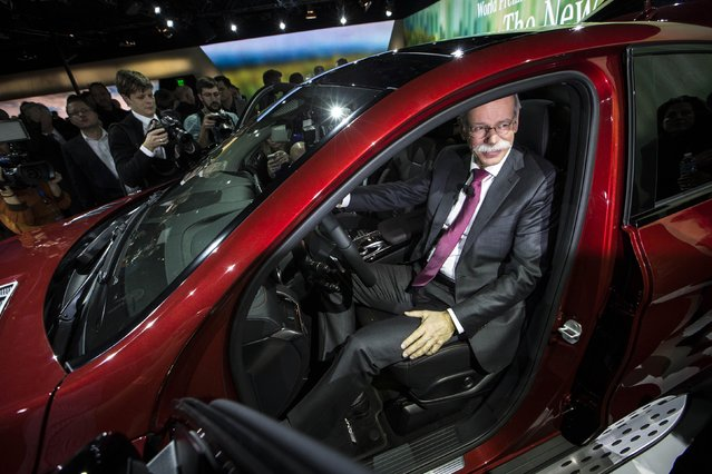 Chairman of Daimler AG and Head of Mercedes-Benz Cars Dieter Zetsche sits in the new Mercedes GLE Coupe during a preview event for the media, ahead of the 2015 North American International Auto Show (NAIAS) in Detroit, Michigan, January 11, 2015. (Photo by Mark Blinch/Reuters)