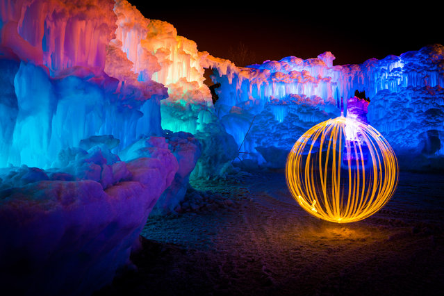 Fire ball in the ice castle. (Photo by Sam Scholes/Caters News)